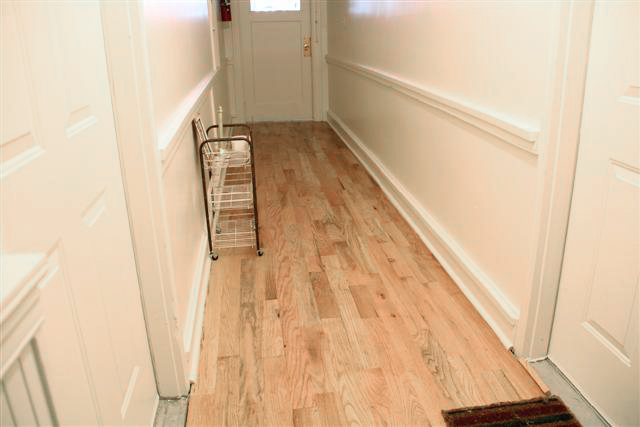 Hardwood floors throughout the interiors and common areas